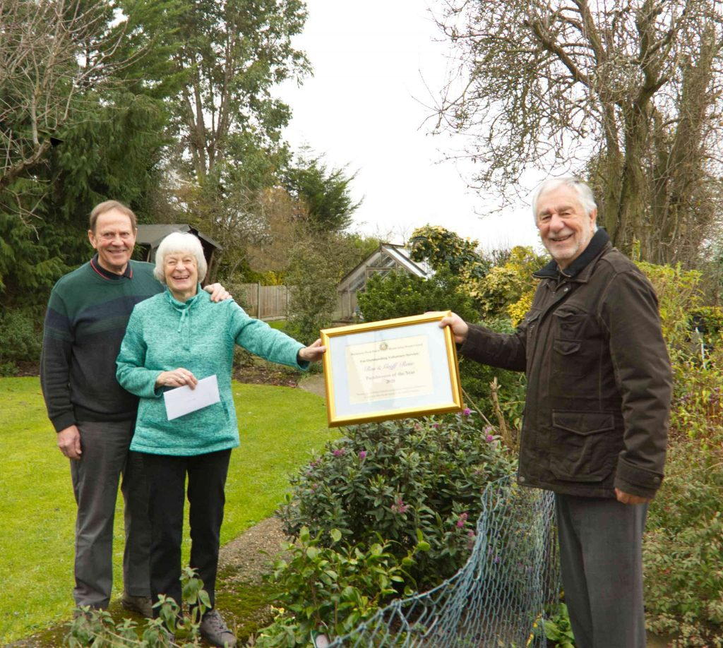 Mr and Mrs Rose (left) receive their award from Cllr Keeble